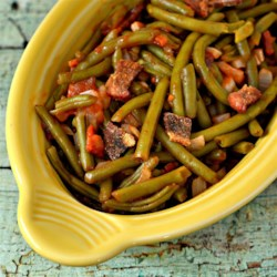 Ruth Cullen's Green Bean Bake Recipe - Green beans are baked into a rich, zesty casserole with chili sauce, onion, bacon, brown sugar and a little dry mustard. This dish will add a little excitement to your vegetables!