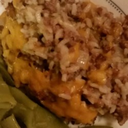 Chuck Wagon Hash Recipe - Chuck wagon hash is a dish that is made up of ground beef, onions, rice, corn, cream of mushroom soup, beef broth, seasonings and topped off with Cheddar cheese.  It's an easy, inexpensive, hearty meal that will have your family begging for more.