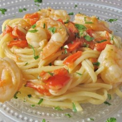 Shrimp Scampi ala Norelllaura Recipe - Try this shrimp scampi recipe served over pasta or simply with fresh bread to sop up the tasty white wine sauce.