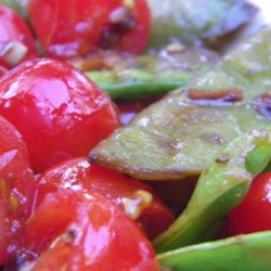 Cherry Tomato Snap Peas Recipe - This quick vegetable side dish doesn't use oil or salt, but is wonderfully flavorful with lemon and garlic.