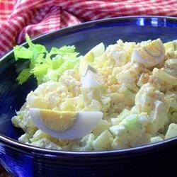 Southern Potato Salad Recipe - This warm potato salad is a classic, with mayonnaise, sweet pickle, garlic, mustard, bits of celery, and diced hard boiled eggs.