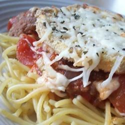 Eggplant Parmesan II Recipe - Eggplant slices are dipped in egg and bread crumbs and then baked, instead of fried.  The slices are layered with spaghetti sauce, mozzarella and Parmesan cheeses.