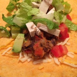 Vegan Bean Taco Filling Recipe - Black beans mingle with onions, peppers, garlic, cornmeal, and spices in this tasty taco filling. Try it in burritos or as a dip for tortilla chips. No black beans? Red, pink, or pinto beans are great subs.