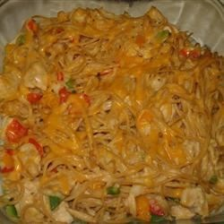 Chicken Spaghetti Recipe - Chunky chicken baked with pimentos, bell peppers and cheese in a mushrooms sauce.