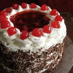 Jenny's Black Forest Cake Recipe - Dark chocolate cake layers are filled with cherry pie filling spiked with cherry liqueur.  If using this recipe to make a 9x13 inch cake, increase the baking time to 40 minutes.