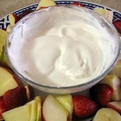 Super Easy Fruit Dip Recipe - This is a fruit dip that's very easy! Blend your favorite yogurt flavor with frozen whipped topping and dip! I use slices of Granny Smith, Golden and Red delicious apples, white & red grapes, orange sections, strawberries, kiwi fruit and pineapple chunks for a platter.