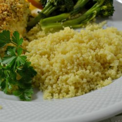 Garlic and Ginger Couscous Recipe - Liven up your couscous by adding ginger and garlic, then simmer it all in chicken broth to make this quick and easy dish.