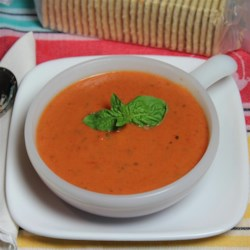 Favorite Basil-Tomato Soup Recipe - Get a delicious pot of creamy, basil-tomato soup by simmering crushed tomatoes, fresh basil, chicken broth, and cream together. Don't forget the butter!
