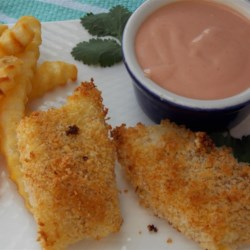 Parmesan Fish Sticks with Malt Vinegar Dipping Sauce Recipe - Homemade Parmesan-crusted fish sticks with a tangy dipping sauce are kid-friendly and only take 30 minutes to prepare.