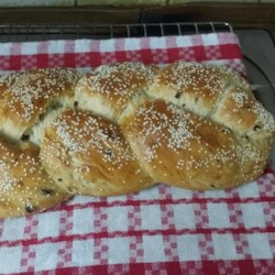 Bread Machine Challah for Shabbat and Festivals Recipe - A traditional challah, but the dough is made and  kneaded in a bread machine. Just put the ingredients in, turn on the machine, and walk away until it's time to braid, glaze, and bake the challah in your oven.