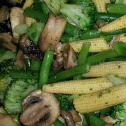 Quick Cajun Vegetables Recipe - Broccoli, green beans, mushrooms, and baby corn become a snappy side dish with a generous spoonful of Cajun seasoning.
