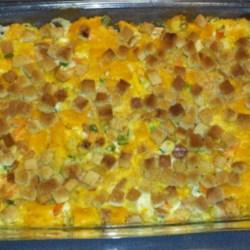 Creamy Squash Casserole Recipe - Creamy and comforting, this side dish casserole has tender pieces of butternut squash in a sour cream sauce with herb-flavored stuffing mix.