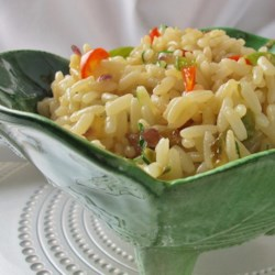 "Green Pepper Rice Recipe - Say ""no!"" to plain white rice and use this recipe to add flavor and color to converted rice with onion, garlic, bell pepper, and parsley."