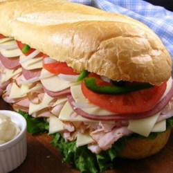 Cholesterol King Heart Stopper 2000 Recipe - The ultimate Super Bowl party sub. This is intended to feed approximately 8 people and weighs in at over 6 pounds. A loaf of French bread is layered with 6 pounds of meat and cheese, with one or two vegetables thrown on for good measure. Remember to lift with your legs, not your back.