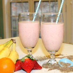 Simple Breakfast Smoothie Recipe - Orange, banana, yogurt, strawberries, and flax seeds make up this recipe for a quick and easy breakfast smoothie.