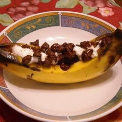 Banana Boats Recipe - A perfect campfire treat, fresh bananas are carefully slit open and stuffed with marshmallows and chocolate chips, wrapped in aluminum foil and cooked for a few minutes until the chocolate is melted. Then just dig in with your spoon!