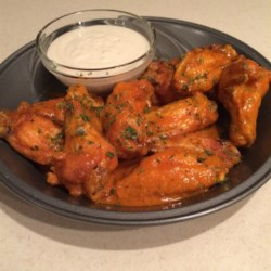 Scott's Coast-to-Coast Famous Chicken Wings Recipe - Deep-fried chicken wings coated in a buttery hot-pepper sauce is a Buffalo original that has become a national sensation.