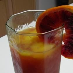 Colorful Beverage Recipe - Cranberry juice poured over orange juice ice cubes.