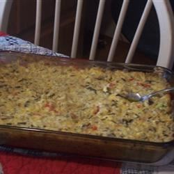 Chicken and Wild Rice Casserole Recipe - Chicken, wild rice, and mushrooms are given fine treatment in this elegant casserole.
