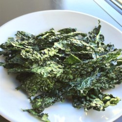 Kale Chips in the Microwave Recipe - This is such a quick and easy way to enjoy a healthy snack. Just drizzle olive oil over kale pieces, season with salt, and crisp in the microwave oven.