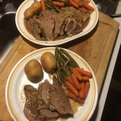 Slow Cooker Roast Recipe - This pot roast recipe is nearly effortless, preparing a pot roast, vegetables, and gravy in your slow cooker as you go about your day, making it a perfect Sunday dinner.