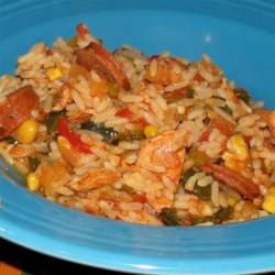 Three-Pepper Rice and Chicken Pot Recipe - This chicken-and-rice dish is filled with a variety of peppers and vegetables to make a very flavorful one-dish meal.