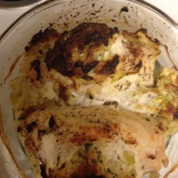 Zucchini Stuffed Chicken Recipe - Chicken breasts are stuffed with a savory zucchini and Swiss cheese stuffing and baked until golden brown in this family-friendly recipe.