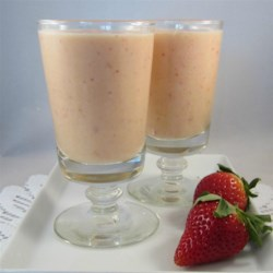 Simple Breakfast Smoothie Recipe - Orange, banana, yogurt, strawberries, and flax seeds make up this recipe for a quick and easy breakfast smoothie.