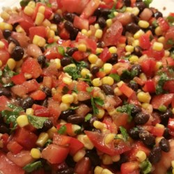 Zesty Black Bean and Corn Salsa Recipe - This simple recipes for a black bean, corn, and tomato salsa is finished with zesty Italian salad dressing.