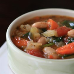 Tuscan Bean Soup (Ribollita)  Recipe - Tuscan bean soup is similar to minestrone but includes cannellini beans instead of pasta. Serve over a bed of sauteed spinach.