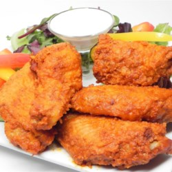 True Wings Recipe - Dress up your traditional fried chicken wings by using this recipe that calls for a generous spice rub and a sweet-hot sauce.