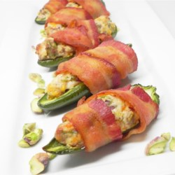 Pistachio-Stuffed Jalapenos Recipe - Jalapeno poppers stuffed with cream cheese and pistachios are wrapped in bacon for a creamy and nutty appetizer everyone will love.