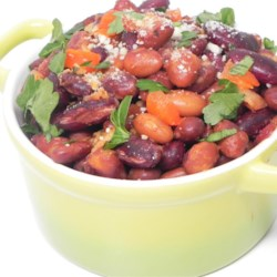 Better Than Ice Cream Baked Beans Recipe - Four varieties of beans, crispy bacon, and Parmesan cheese are baked into a deliciously simple side dish everyone will enjoy.