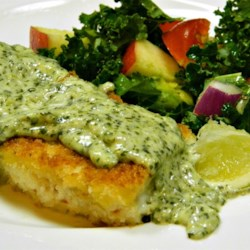 Panko Crusted Halibut with White Serrano and Cilantro Sauce Recipe - Panko-crusted halibut files are oven baked and topped with a serrano pepper and cilantro sauce to create this delicious dinner.