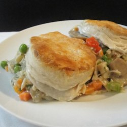 Easy A La King Biscuit Casserole Recipe - An A La King mixture including cubed chicken, peas, mushrooms, bell pepper and broth is poured into a casserole dish and baked with biscuits on top. Classic A La King goes casserole!