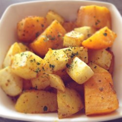 Christmas Roasted Vegetables Recipe - Seasonal root vegetables including squash, sweet potatoes, carrots, and rutabaga have a sweet and hearty flavor when roasted with olive oil and herbs. This side dish is great to serve with beef, pork, and poultry.