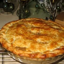Left-Over Turkey Pot Pie Recipe - Leftover turkey and gravy inspired this savory pot pie that includes onions, mushrooms, garlic, and frozen vegetables in a savory main dish that extends the pleasures of a holiday meal.