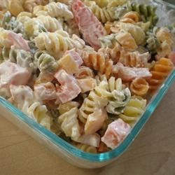 Italian Confetti  Pasta Salad Recipe - Tomatoes and basil, fresh from the garden, are tossed with olives, bell peppers, rotini pasta, then dressed with a creamy, piquant blend of mayonnaise, red wine vinegar and garlic. Let the salad chill overnight to bring out the snappy flavors.