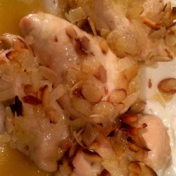 Honey Almond Chicken Recipe - Chicken pieces are baked with a simple honey, lemon, and almond sauce.