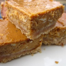 Yummy Pumpkin Cheesecake Bars Recipe - Pound cake mix makes a dense and moist crust for this creamy and smooth pumpkin cheesecake bar.
