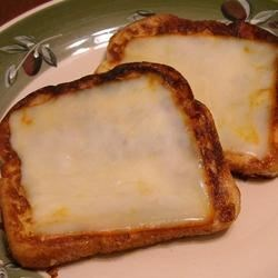 German French Toast Recipe - French toast topped with muenster cheese. I know it sounds weird, but you have to taste it!