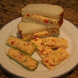 Tom's Sweet Pimento Cheese Recipe - This version of pimento cheese is sweetened with pickle relish. It is great as a sandwich, as a spread on crackers, or stuffed into celery.