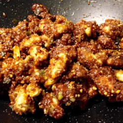 Crispy Kung Pao Chicken Recipe - Crispy, panko breaded chicken tenders are tossed with peanuts in a sweet and spicy sauce.