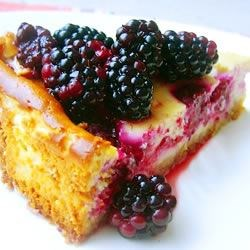 Very Berry Cheesecake Recipe - A rich reward for picking your way through the thorny brambles. Use your choice of fresh raspberries, blueberries, blackberries, boysenberries and/or chopped pitted cherries. If you don't want to use alcohol, you may substitute orange juice.