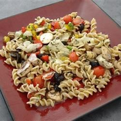 Quick Artichoke Pasta Salad Recipe - This pasta salad is quick and easy to make. The liquid from the marinated artichoke hearts makes an excellent dressing.
