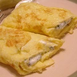Herbed Cream Cheese Omelet Recipe -  Omelet phobia? Not with this recipe. Follow the directions and you 'll create not only perfect omelets, but omelets that your guests will swoon over. Eggs, cilantro, butter and cream cheese ...and a bit of technique.