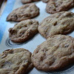 Toffee Crunch Cookies Recipe - Bits of toffee candy and pecans give these cookies a distinctive taste and texture that will have everyone grabbing seconds.