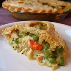 Turkey Pot Pie Recipe - Cooked turkey, celery, carrots, onions, and potatoes in a creamy homemade sauce are baked in flaky pastry in this classic pot pie recipe.