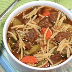 Peruvian Beef Noodle Soup (Sopa Criolla) Recipe - This Peruvian version of beef noodle soup uses fideo pasta and features carrot and zucchini with the beef.