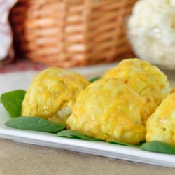 Curry and Cheese Cauliflower Recipe - A curried mayonnaise layer is spread onto cauliflower and topped with Cheddar-Monterey Jack cheese for a creamy and delicious way to eat your vegetables.